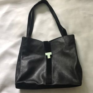 Tanner handbag made in Italy